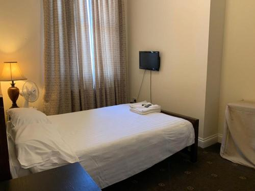 A bed or beds in a room at Citystay Guest House