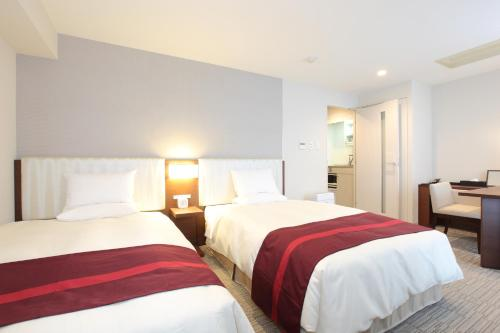 A bed or beds in a room at Tokyu Stay Shibuya
