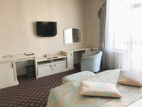 Телевизор и/или развлекательный центр в Отель Европа