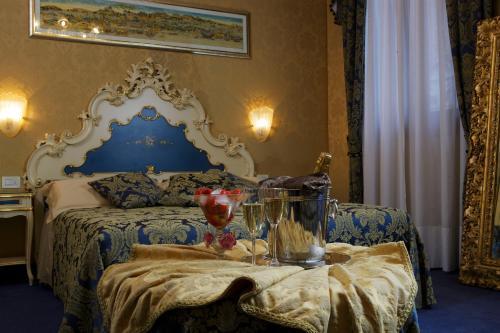 Cama ou camas em um quarto em Hotel Becher