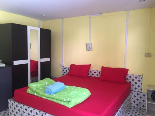 A bed or beds in a room at Bussaracum Resort