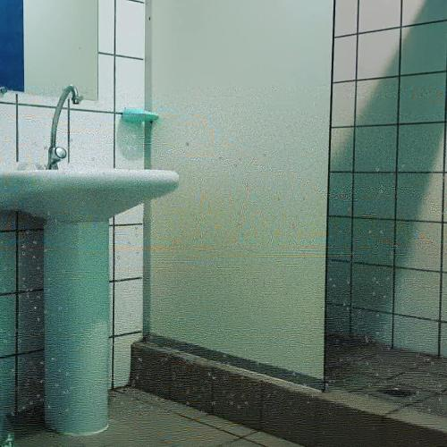 Um banheiro em Pandora Hostel