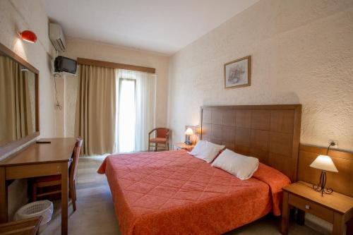 Кровать или кровати в номере Popi Star