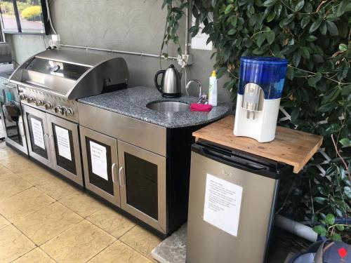 A kitchen or kitchenette at Black Forest Motel