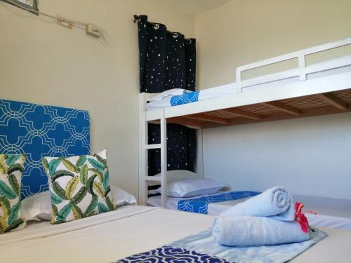 A bunk bed or bunk beds in a room at Happy's Homestay