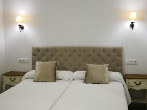 A bed or beds in a room at Casona de San Andrés