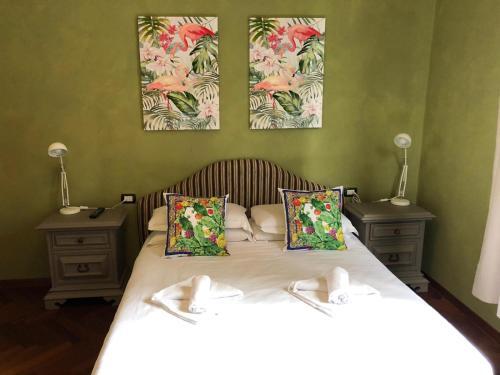 Letto o letti in una camera di Villa il Leone