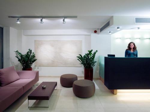 The lobby or reception area at El Greco Hotel