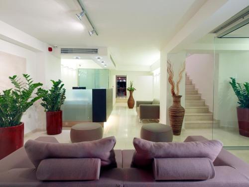 A seating area at El Greco Hotel