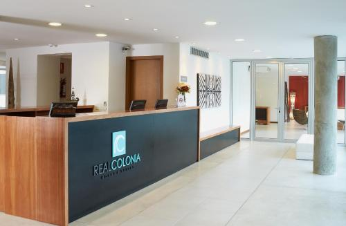 The lobby or reception area at Real Colonia Hotel & Suites