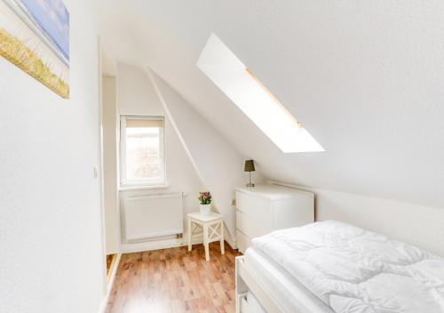 Ein Bett oder Betten in einem Zimmer der Unterkunft Kapitänsferienhaus