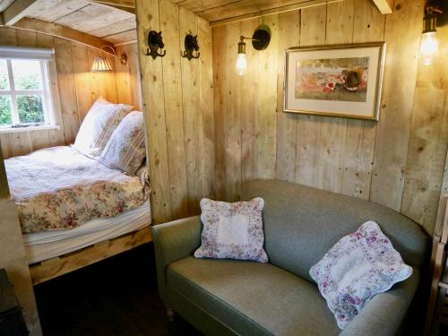 A bed or beds in a room at The Wayside Shepherd Hut