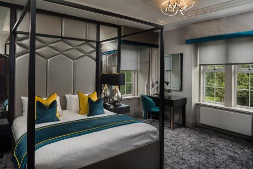 A bed or beds in a room at Dalmeny Park House Hotel