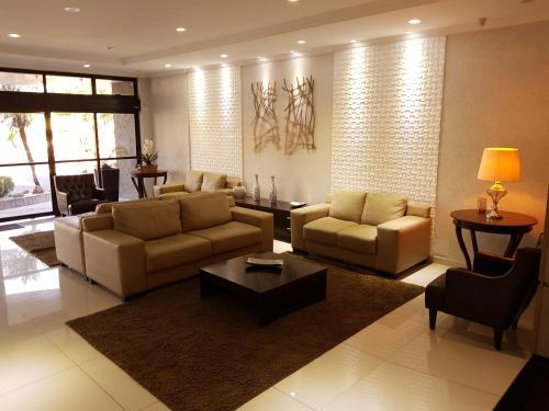 Uma área de estar em Hotel Cristal Rio Claro