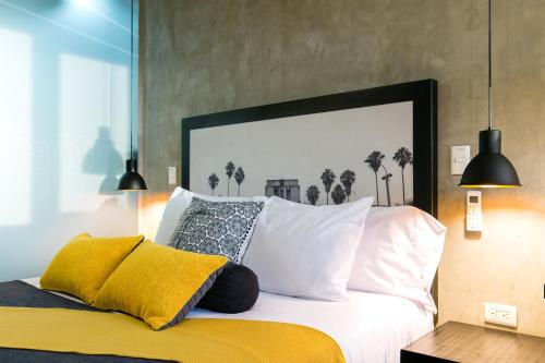 A bed or beds in a room at Epic Boutique Hotel