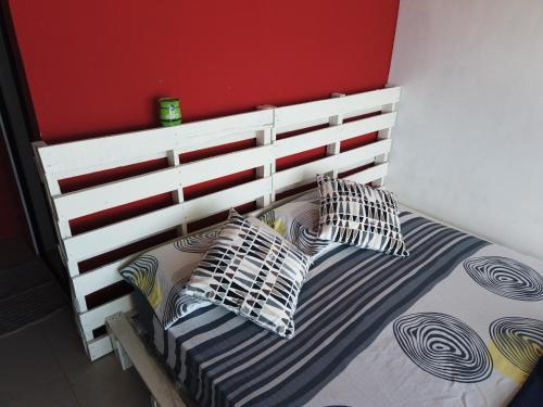 A bed or beds in a room at Tioman Cabana Bed & Breakfast