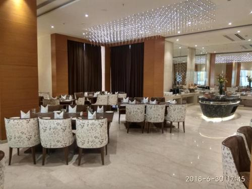 A restaurant or other place to eat at Nataraj Sarovar Portico