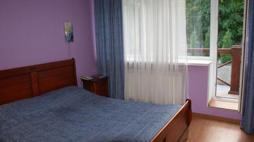 Кровать или кровати в номере Дом Лесника