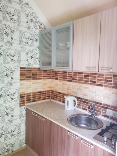 Кухня или мини-кухня в Гостевой дом Serdce Prirody