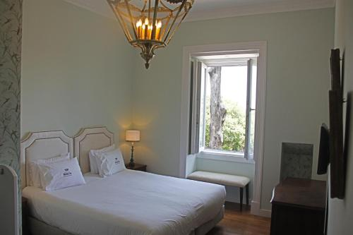 A bed or beds in a room at Casa do Principe