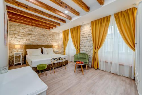 A bed or beds in a room at Princ Heritage Rooms