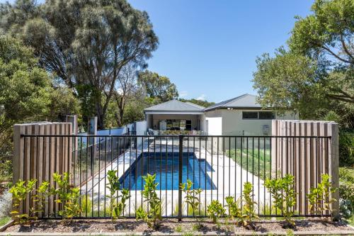 A view of the pool at The Retreat - Poolside Stunner at Rye Back Beach or nearby