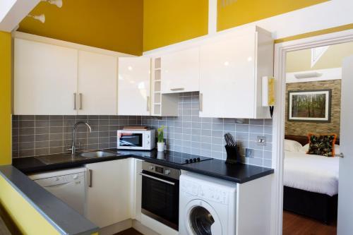 A kitchen or kitchenette at Les Ormes Resort