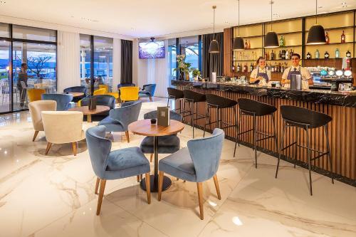 Luxury Hotel Rivaにあるラウンジまたはバー