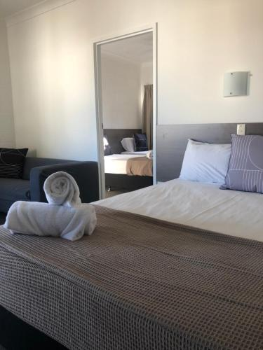 A bed or beds in a room at Q Express
