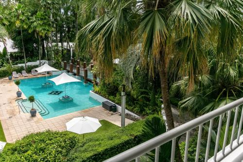 """A view of the pool at Belle Escapes - Poolside Apartment Alamanda Beachfront Resort """"56"""" or nearby"""