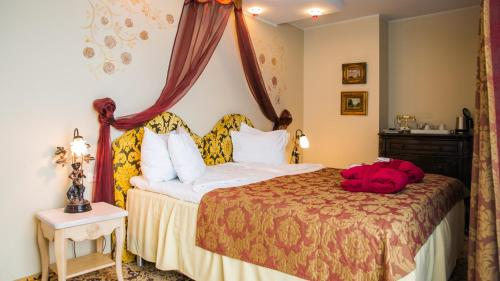 Voodi või voodid majutusasutuse Grand Rose SPA Hotel toas