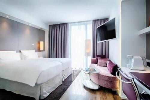A bed or beds in a room at Boutique Hotel i31 Berlin Mitte