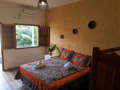 Cama ou camas em um quarto em Pousada Frau Spring