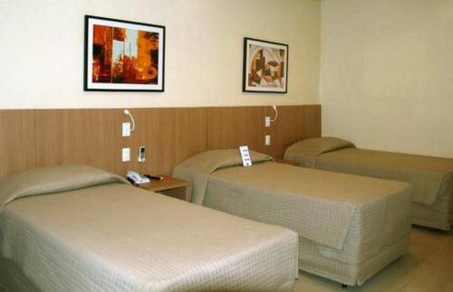 A bed or beds in a room at Rio Aeroporto Hotel