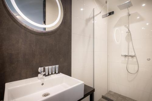 Een badkamer bij Hotel New Kit