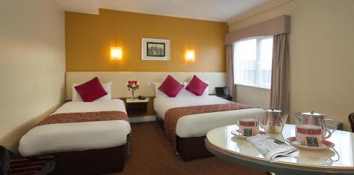 Un ou plusieurs lits dans un hébergement de l'établissement Eviston House Hotel