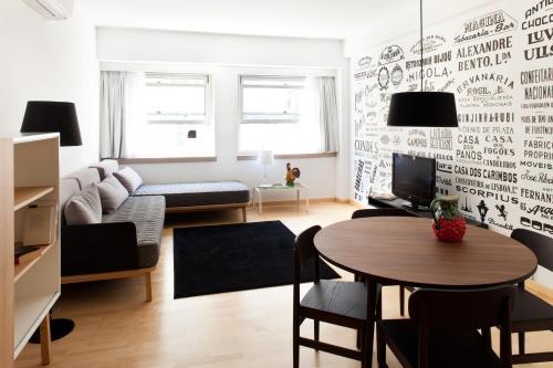Uma área de estar em The Lisbonaire Apartments