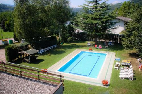 A view of the pool at Hotel Dolomiti or nearby