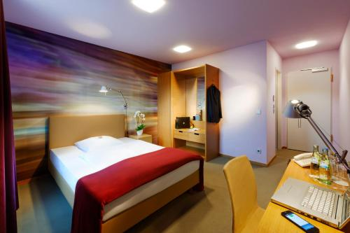 A bed or beds in a room at Hotel Königstein