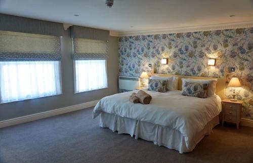 Кровать или кровати в номере Franklins Apartments