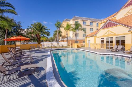 The swimming pool at or close to La Quinta by Wyndham Orlando Universal area