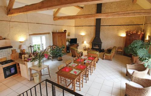 A restaurant or other place to eat at Holiday home Dame Marie les Bois 41