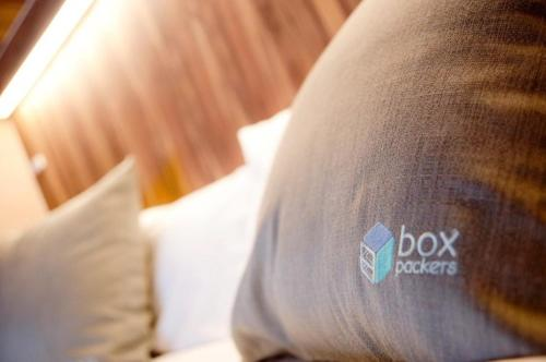 A bed or beds in a room at Boxpackers Hostel Pratunam