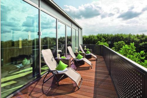 Ein Balkon oder eine Terrasse in der Unterkunft Mövenpick Hotel Münster