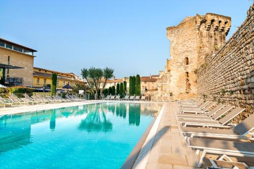 The swimming pool at or close to Aquabella Hôtel & Spa