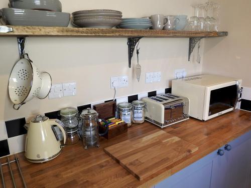 A kitchen or kitchenette at Heatopia Apartment