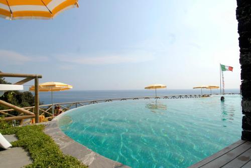 The swimming pool at or near Hotel Porto Roca