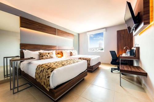 A bed or beds in a room at Sleep Inn Villahermosa