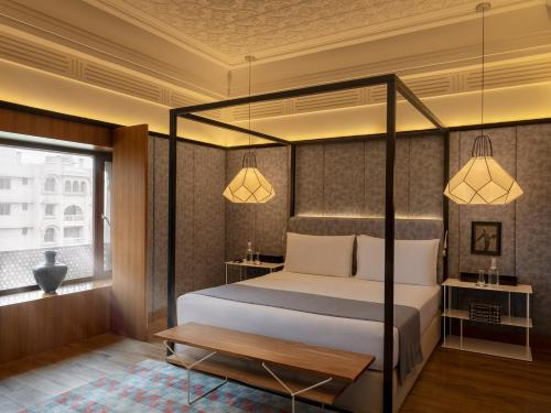 A bed or beds in a room at Narendra Bhawan