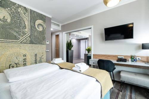 A bed or beds in a room at Hotel Perfect